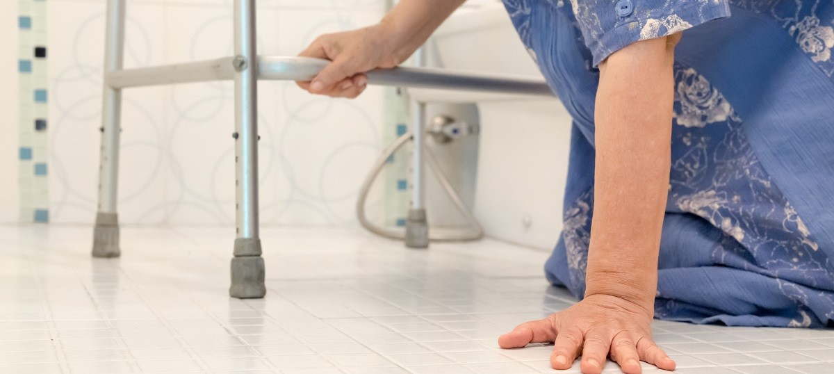 Resident getting up from falling down using a walker for stability